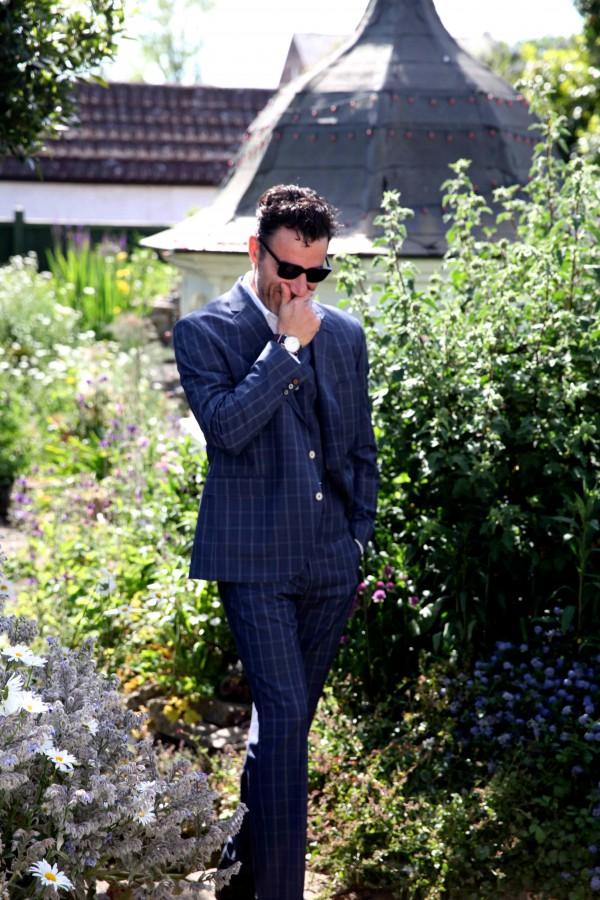 Local animator, Ben Lewis, wearing Gibson London Suit, Timex Watch and Monokel Sunglasses. ©James Marsh